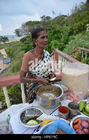 Mumbai, India - October 26, 2015 - Indian food charmuri prepared by woman in Mumbai - Stock Photo