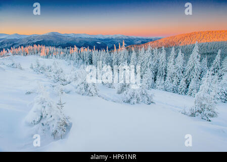 Fantastic winter landscape. Magic sunset in the mountains a fros - Stock Photo