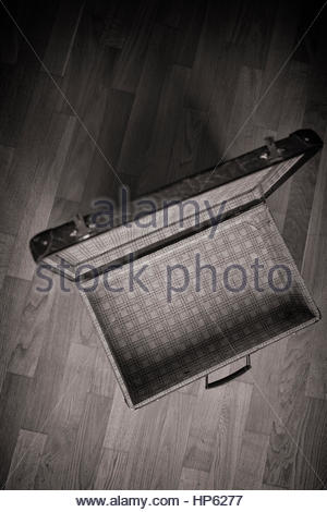 Old suitcase still life open wooden floor - Stock Photo