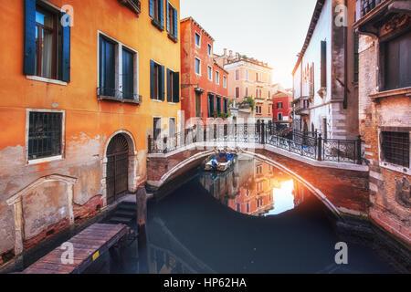 Gondolas on canal in Venice, Italy - Stock Photo