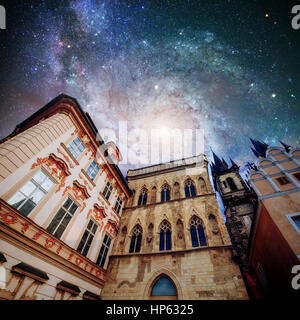 Fantastic starry sky and the milky way. Beautiful houses Czech R - Stock Photo