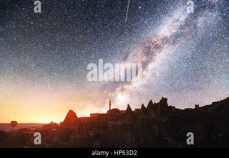 Fantastic starry sky and majestic mountains in the mist. Dramatic  beautiful morning. Autumn landscape. Courtesy - Stock Photo