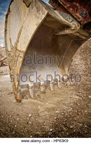 Excavator shovel bucket digger earth mover teeth - Stock Photo