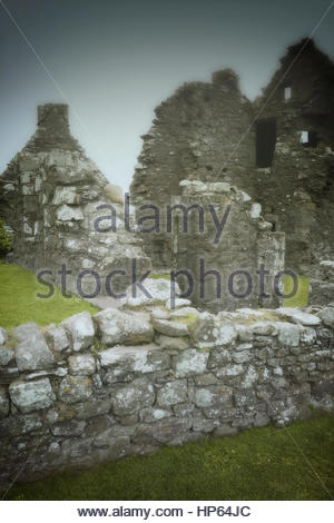 Old ruin castle stone house haunted fog spooky - Stock Photo
