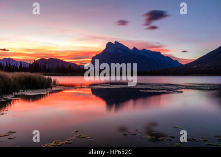 Sunrise from the shore of the Vermillion Lakes in Banff National Park, Alberta, Canada - Stock Photo