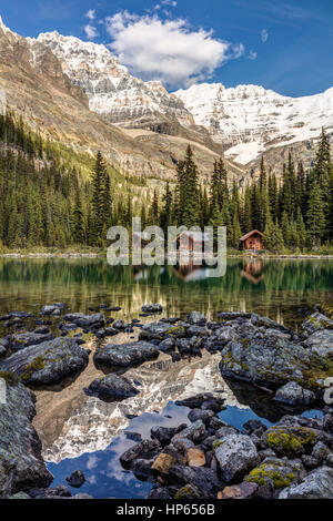 Lake O'Hara Lodge in Yoho National Park, British Columbia, Canada. Idyllic Mountain scenery and reflection in the - Stock Photo