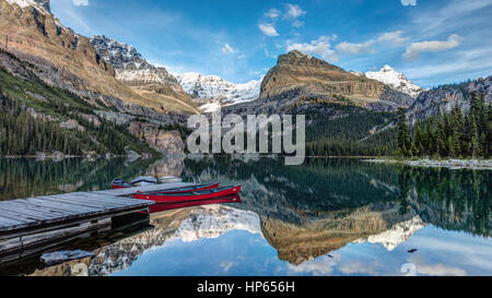 Lake O'Hara Canoes in the Wilderness of Yoho National Park, British Columbia, Canada - Stock Photo