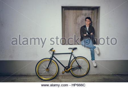 Young cool man posing fixie bicycle Hipster trendy - Stock Photo