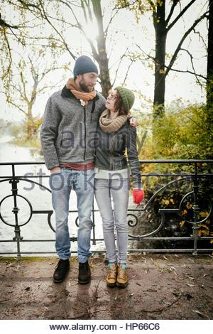 Heterosexual couple bridge hugging loving in love - Stock Photo