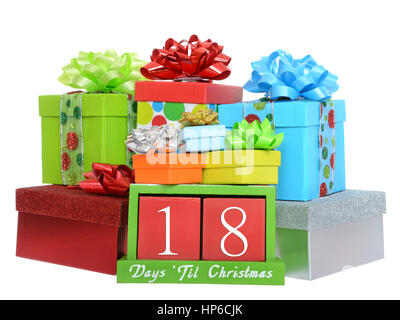 18 Days until Christmas red wood blocks in a green box with presents stacked on and around it isolated on a white - Stock Photo