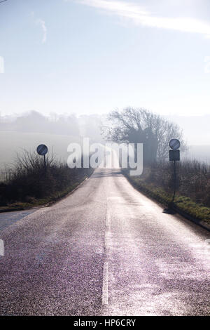 country lane winding into distance on misty morning, road sign, countryside, mist, sky