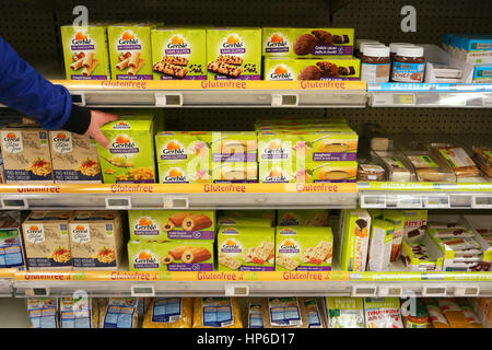 Shelves with various glutenfree products in a Supermarket. - Stock Photo