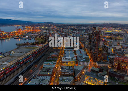 Vancouver, Canada - January 28, 2017: Vancouver cityscape at night with the harbour, Gastown and mountains in the - Stock Photo