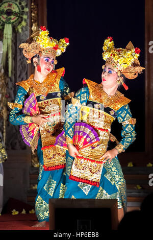 Two Balinese female dancers on stage. - Stock Photo
