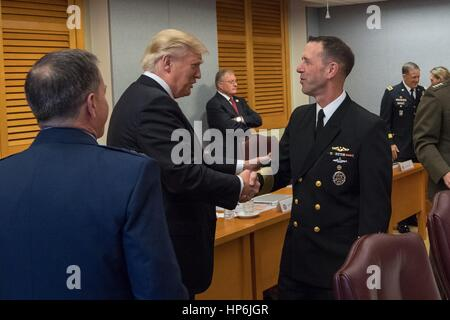 U.S. President Donald Trump greets Adm. John M. Richardson, Chief of Naval Operations as he arrives to attend the - Stock Photo
