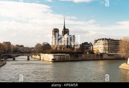 Scenic view of Notre-Dame de Paris with Saint-Louis and Cite islands on a bright day. - Stock Photo