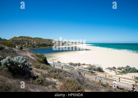 A view of the beach where Moore river meets Atlantic ocean - Stock Photo