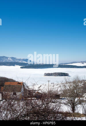Frozen Vlasina lake in Serbia with blue sky - Stock Photo