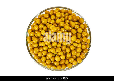 Glass bowl of pickled green pea on white - Stock Photo