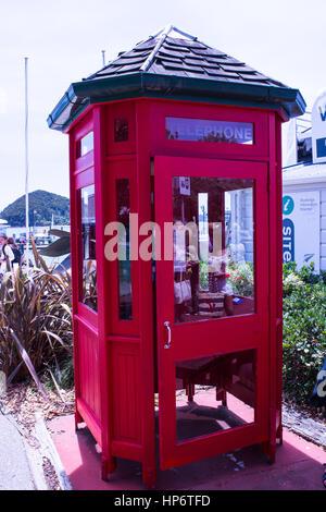 Red phone box at Paihia New Zealand - Stock Photo