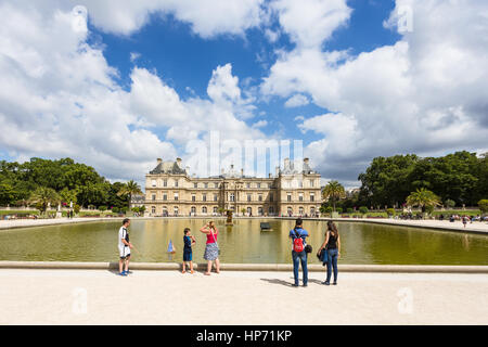 PARIS - AUGUST 6, 2016: Tourist enjoy view of the Luxembourg Palace in Paris, France capital city. - Stock Photo