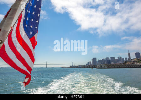 San Francisco Financial District skyline and Oakland Bridge on sunny day, California, United States. Sea views from - Stock Photo