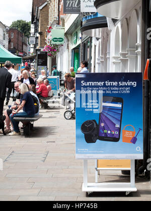 O2 mobile phone shop sign on the busy main shopping street - Stock Photo