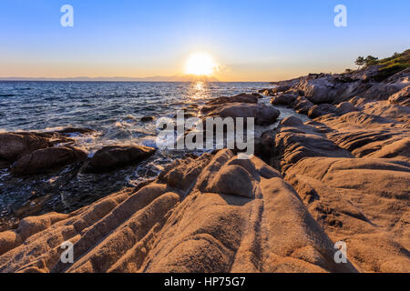sunrise in Orange Beach. The east coast of Sithonia peninsula, Halkidiki, Greece. - Stock Photo