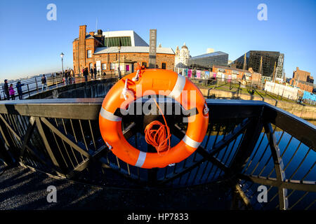 Orange lifebelt at Pier Head on Albert Dock on Liverpool's historic  waterfront, UK (taken with fish eye lens) - Stock Photo