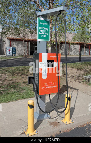 Electric vehicle charge point in Mystic Seaport car park,Mystic, Connecticut, United States. - Stock Photo