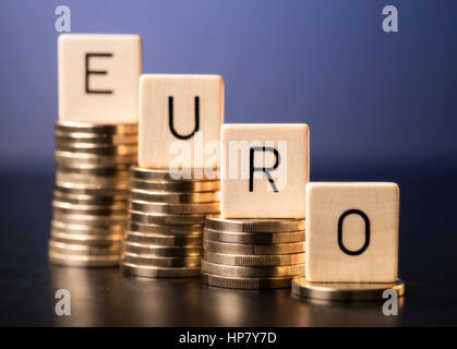 Money Euro Word With Letters And On Wooden Background Stock Photo