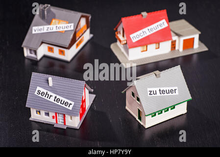 Houses with labels that symbolize overpricing. - Stock Photo
