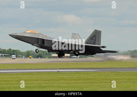 Lockheed Martin F-22 Raptor stealth fighter jet plane taking off at the Royal International Air Tattoo at Fairford. - Stock Photo