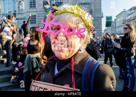 Mature woman wears novelty LOVE spectacles at the Reclaim Love pavement party, Leicester Square, London, UK - Stock Photo