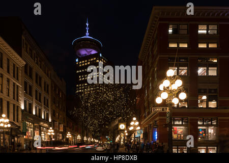 Vancouver, Canada - January 28, 2017: Gastown, Vancouver at night with the steam clock and Vancouver Lookout in - Stock Photo