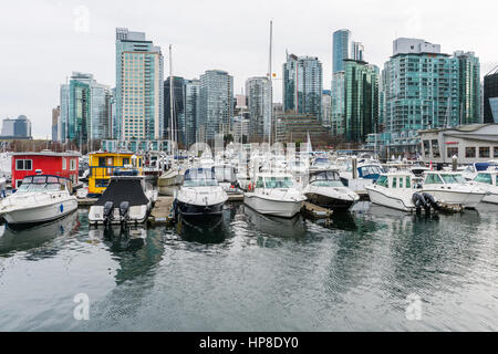 Vancouver, Canada - January 28, 2017: Vancouver city skyline with boats in foreground - Stock Photo