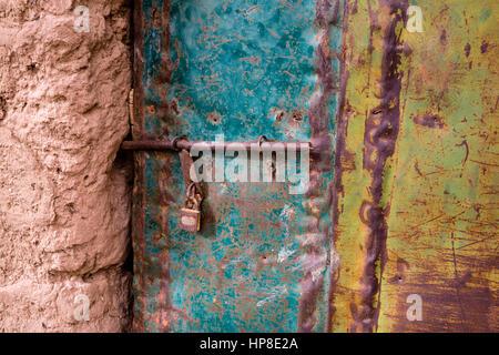 Zagora, Morocco.  Lock on Door to Old House in Area of Small farm Plots. - Stock Photo