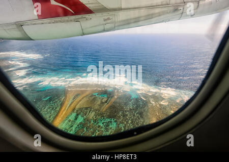 Flying over a reef near Lord Howe Island, in a QantasLink twin propellor De Havilland aircraft, New South Wales, Australia