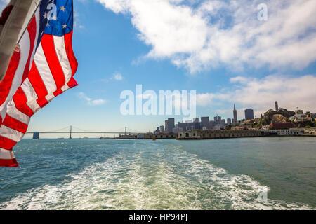San Francisco Financial District cityscape and Oakland Bridge on sunny day, California, United States. Sea views - Stock Photo