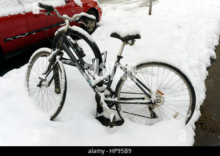 Parked Raleigh bicycle covered in snow, Vancouver, British Columbia, Canada - Stock Photo