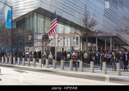 People wait in line to enter the National September 11 Memorial Museum in New York City. - Stock Photo