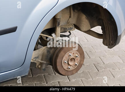 Closeup the disc of a car and disassembled wheel during the servicing Stock Photo