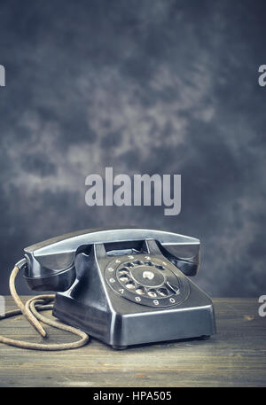 Old black phone vertical - Stock Photo