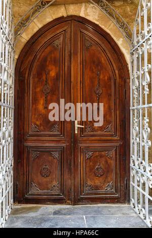 Ancient wooden door in Old city, Icheri Sheher at Baku, Azerbaijan. - Stock Photo