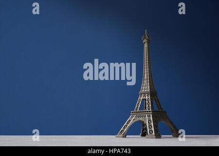 Souvenir Eiffel Tower on a blue background - Stock Photo