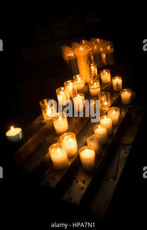 Candles burning in a church - Stock Photo