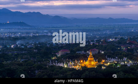Beautiful Khuthodaw Pagoda with light in the early morning view from Mandalay hill, Myanmar - Stock Photo