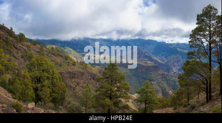 central Gran Canaria in January,  View towards Roque Bentayga from a hiking path, overcast day - Stock Photo