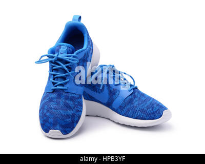 SAMARA, RUSSIA - June 8, 2015: female Nike sneakers for running, training, in gray and blue, showing the Nike logo, - Stock Photo