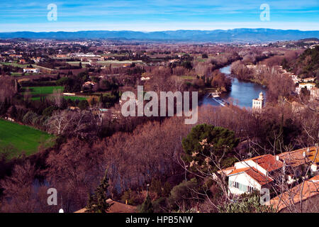 a view of the Orb River bordering Beziers, France, in winter - Stock Photo